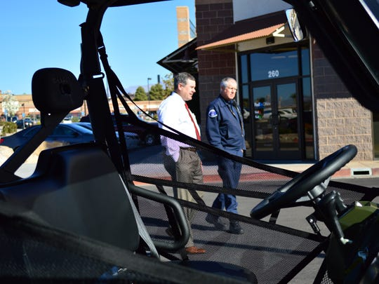 St. George Mayor Jon Pike, left, and Fire Chief Robert Stoker discus the new Polaris Ranger the station received Tuesday from the Firehouse Subs Public Safety Foundation.