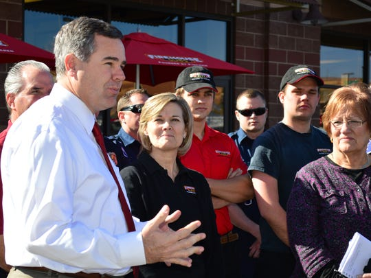 St. George Mayor Jon Pike speaks to the crowd gathered at Firehouse Subs Tuesday for the donation event.