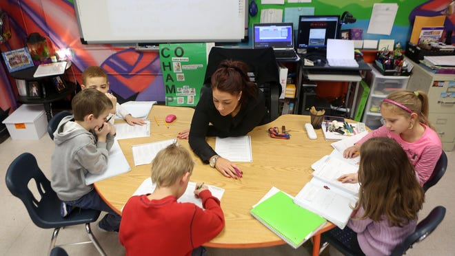 Kentucky Gov. Matt Bevin's proposal to reduce spending on education will hurt students across the commonwealth, says the superintendent of Dayton Independent Schools. Shown, Tara Macke, a third-grade teacher at Glenn O. Swing Elementary in Covington, works with her students on math problems in 2015.