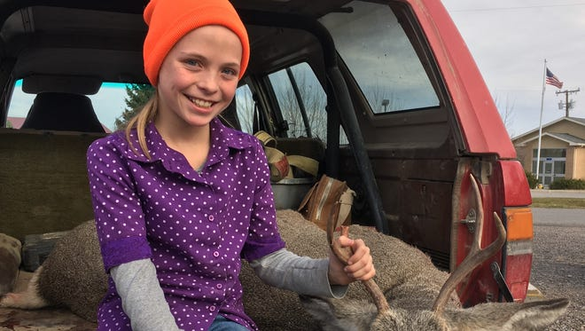 Clara Bradshaw bagged a mule deer buck during the youth deer season and checked it in at the Augusta game station Thursday. The general hunting season opened Saturday.