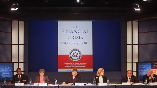 Members of the Financial Crisis Inquiry Commission, speak about the release of the commission's report on the causes of the financial and economic crisis, in Washington, Thursday, Jan. 27, 2011.  From left are, John W. Thompson, Brooksley Born, Chairman Phil Angelides, Heather H. Murren, Byron S. Georgiou, and Bob Graham.