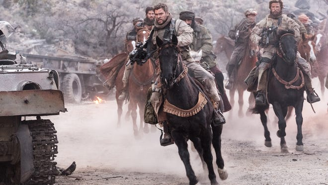 """Chris Hemsworth, front, as Capt. Mitch Nelson and Thad Luckinbill, right, as Vern Michaels in """"12 Strong."""""""