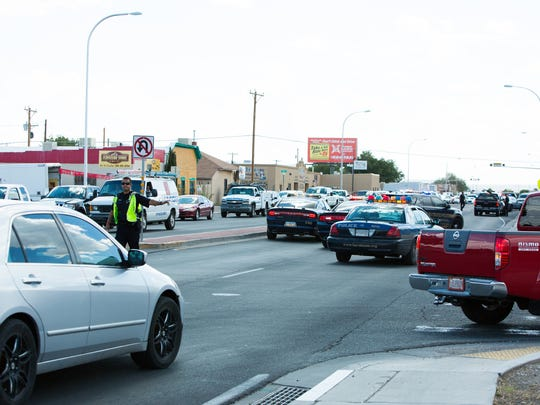 A Las Cruces Police Officer conducts traffic assignments, August 19, 2016, after a car chase ends with a crash Friday afternoon on Picacho and 3rd streets.