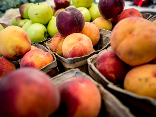 Fresh peaches are displayed Friday, September 2, 2016 at the Marysville Farmers Market.