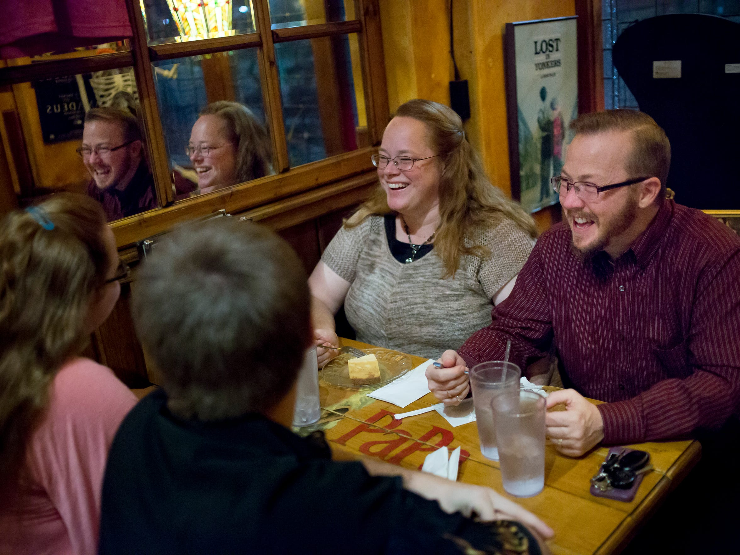 Seth Carwyn laughs along with his wife, Christine Carwyn, while they have dinner with their children, Peter Forsgren, 21, and Cathy Forsgren, 19, Thursday, Oct. 13, 2016 at The Raven in downtown Port Huron.