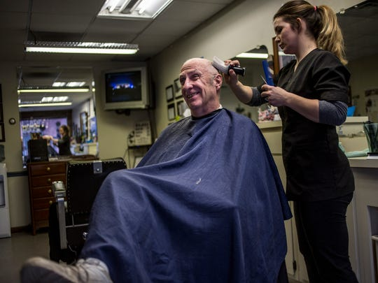 "Mike Heffrom, a Yale resident of more than 25 years, gets his hair cut by Chelsea Kreiner, of Brown City, Wednesday, Jan. 11, 2017 at Barbers on Main in Yale. ""It's an unknown to me,"" Heffrom said of the Fourth Class City Act."