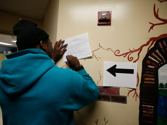 Tim Sanders, a counselor at the Haverstraw Center fills out a survey form during the annual homeless point in time count in Rockland on Jan. 26, 2017.