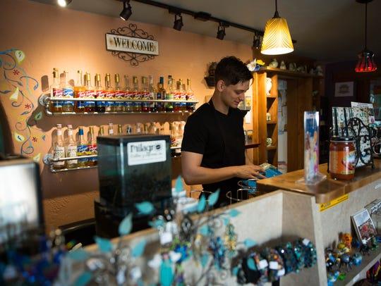 Jacoby McKinney, a barista at Café de Mesilla, organizes