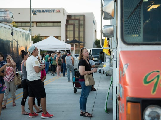Food trucks lined the Plaza de Las Cruces along with different vendors in the plaza, during the first evening farmers market of the year. Wednesday, June 14, 2017.