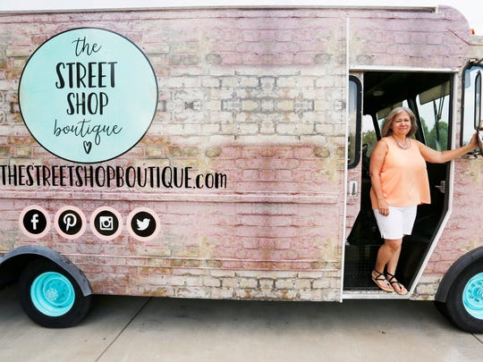 Brenda Durham with The Street Shop Boutique, a women's fashion truck, Friday, June 1, 2018, near Brookston. Formerly a Hudlow Dry Cleaners delivery truck, Durham and her daughters Lindsey Tillotson, Jessica Burke and Leah Stoll will use the truck to take women's fashions on the road. They plan to take the truck to sell women's fashions at farmers markets, festivals, home shows and more.