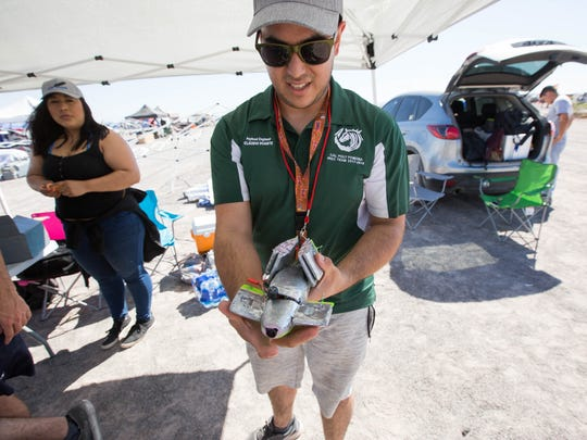 Claudio Duarte, a payload engineer with the Cal Poly Pomona Rocket Team, shows a drone, the team's payload, which will separate and launch from the rocket at 400 feet off the ground, Friday June 22, 2018 at the Spaceport America Cup.