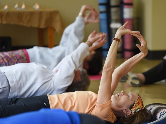 Kay Mortimer, foreground, participates in Yahweh Yoga