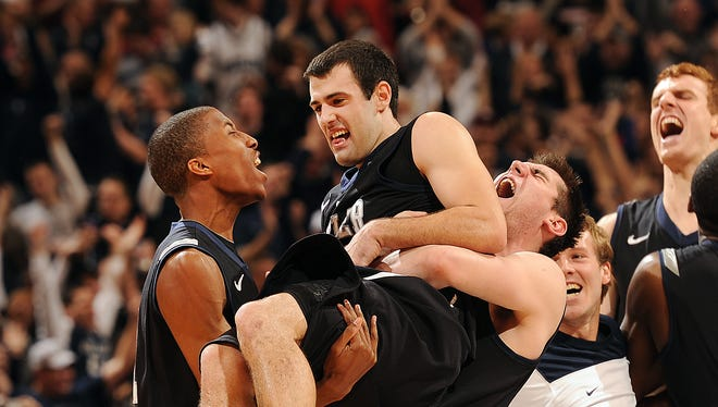 Butler's Andrew Smith,right, lifts up Alex Barlow as the Bulldogs defeated the Hoosiers 88-86 in overtime of their game during the  2012 Crossroads Classic at Bankers Life Fieldhouse.  Matt Kryger / The Star