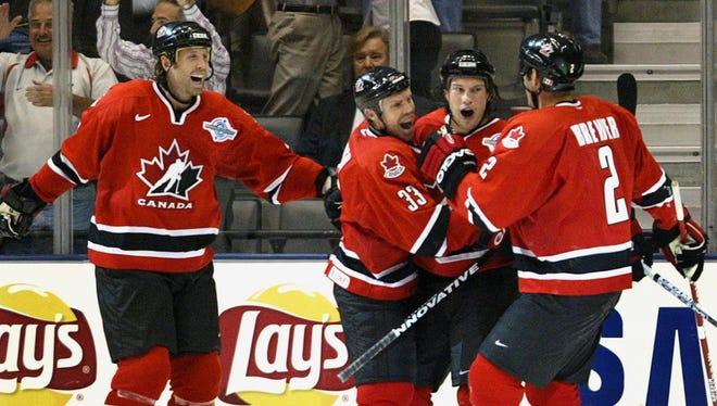 Team Canada players celebrate a Shane Doan goal in the 2004 World Cup final.