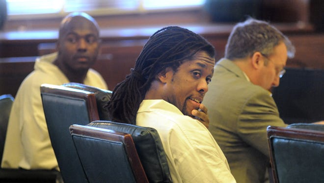Robert Wilcoxson, left, and Kenneth Kagonyera listen as a three-judge panel hears claims of their innocence in September 2011. Both pleaded guilty to second-degree murder to avoid a possible sentence of life in prison or death in the 2000 slaying of Walter Rodney Bowman, 51, at his home in Fairview.