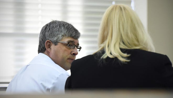 Eric Johnson talks with his attorney Betsey Lund during the second day of his civil lawsuit trial against the city of Cold Spring in August at the Stearns County Courthouse.