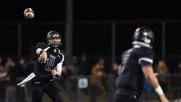 Sussex Tech senior quarterback Justin Hill throws to
