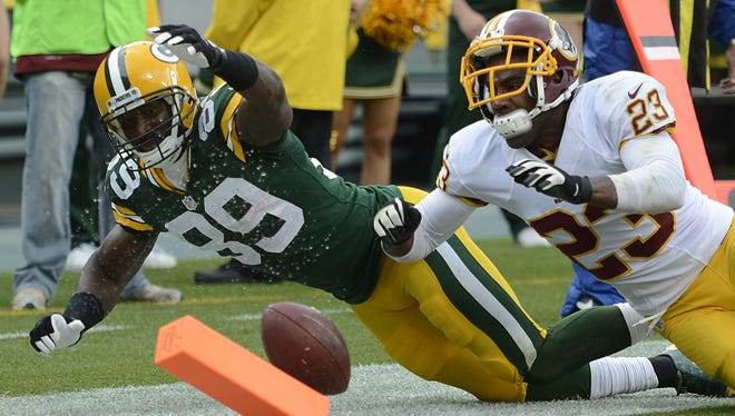 Green Bay Packers receiver James Jones (89) loses the football while reaching for the pylon in the second quarter against Washington in 2013.