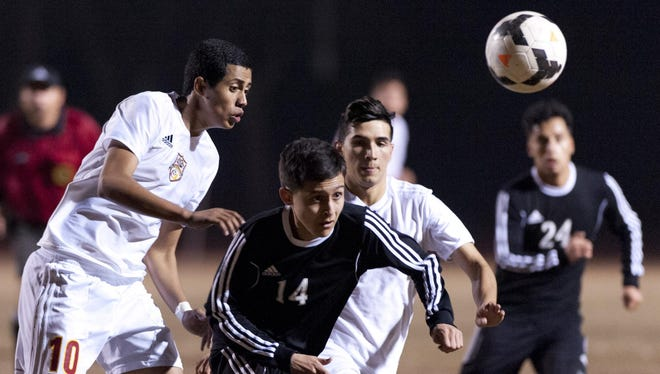 Tulare Union's Adin Cortez, left, Bryan Montes (15) and Mission Oak's Carlos Beltran (14) go after a loose ball on Monday in an East Yosemite League match at Bob Mathias Stadium. Mission Oak's Jose Benitez is at right.