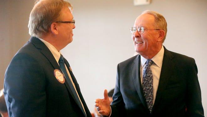 Tim Rudd, left, talks with U.S. Sen. Lamar Alexander before Alexander spoke at the Murfreesboro Rotary lunch meeting Tuesday, Feb. 16, 2016.