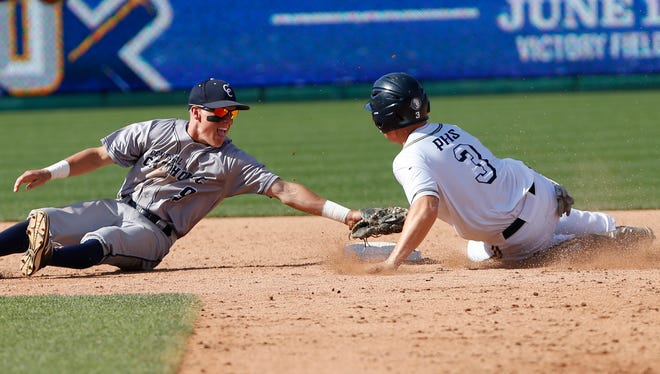 Central Catholic shortstop Tyler Powers lunges to tag Tré Watson of Providence out at second in the bottom of the fourth inning in the Class 2A State Championship Saturday, June 18, 2016, at Victory Field in Indianapolis. CC lost to Providence 7-6.