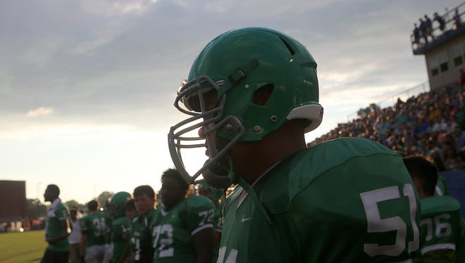 Bolivar Central's Briason Mays (51) looks on from the sidelines as the Tigers face off against Adamsville during the Star Physical Therapy Jamboree at Chester County High School's Eagle Stadium in Henderson, Tenn., on Friday, Aug. 12, 2016.