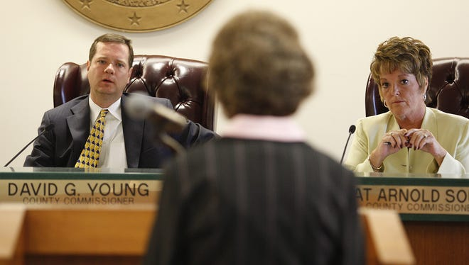 Warren County Commissioners David Young, left, and Pat South, right, in a 2009 meeting.