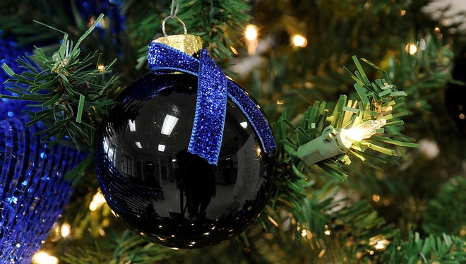 Six black ornaments with blue ribbons represent the six members of law enforcement killed this year in Tennessee.