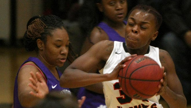 South Side's Tamia Curry (34) drives against Haywood's Victoria Perry (12) at South Side High School in Jackson Friday.