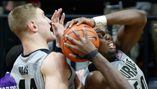 Caleb Swanigan ribs down a rebound in front of teammate Isaac Haas against Northwestern.