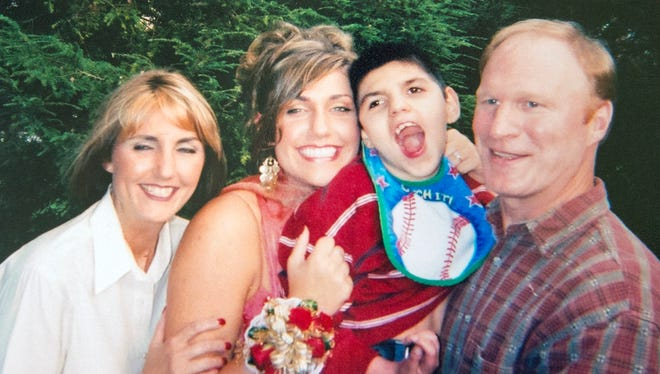 From the left, Alexandria Crawford, sister, Kimberly Acworth, mother, Carson McChord, and Todd Keating in a family photo from 2005.