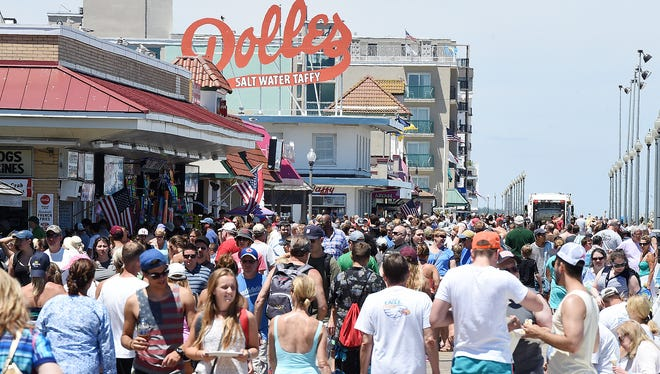 The summer tourism boom brings out the crowds in Rehoboth Beach on Fourth of July weekend last year.