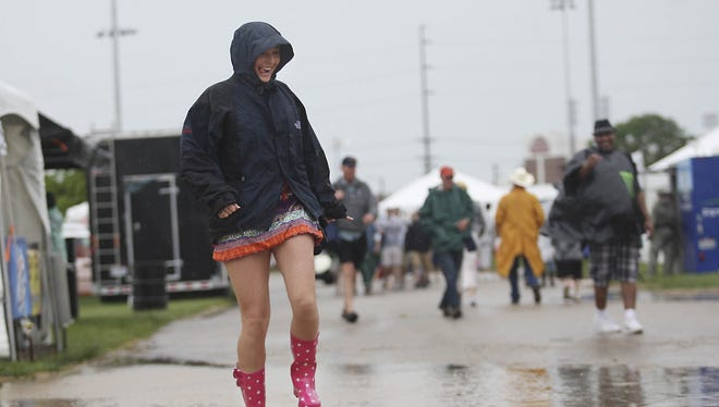 It was a splish-splash time for Leah Layman of Florida as she waded through a large puddle at the infield at Churchill Downs on Kentucky Derby morning in 2010.