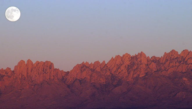 As dusk settles upon the city of Las Cruces on May 4, 2012, a full moon emerges from behind the Organ Mountains.