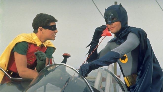 The Dynamic Duo!  Burt Ward as Robin, left, watches Adam West as Batman talks on the bat phone in a scene from the television show 'Batman' in this undated photo.