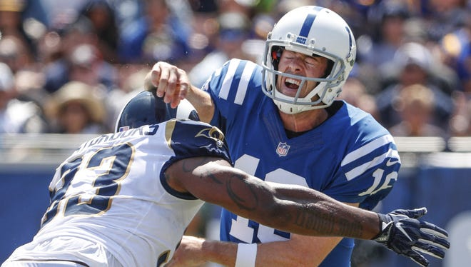 Indianapolis Colts quarterback Scott Tolzien (16) is hit by Los Angeles Rams defensive end Ethan Westbrooks (93) after a throw during the first quarter at Los Angeles Memorial Coliseum in Los Angeles on Sunday, Sept. 10, 2017.