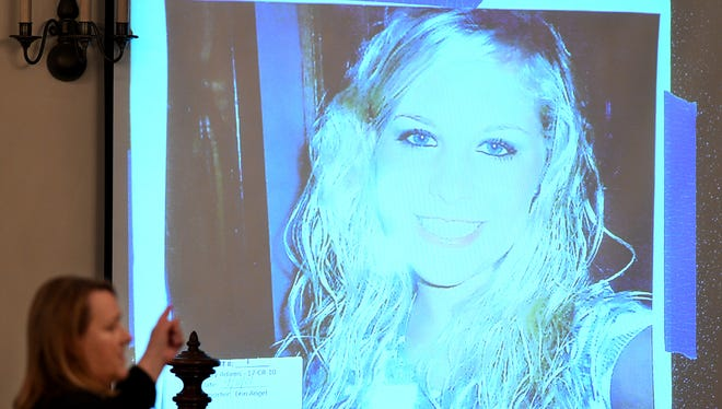 State prosecutor Jennifer Nichols points to a photo of Holly Bobo during her closing argument rebuttal on day 10 of the Bobo murder trial Thursday, Sept. 21, 2017, in Savannah, Tenn. Zach Adams is charged with felony first-degree murder, especially aggravated kidnapping and aggravated rape of Bobo.