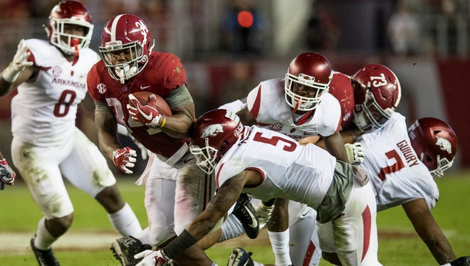 Alabama running back Damien Harris (34) carries against Arkansas in second half action at Bryant Denny Stadium in Tuscaloosa, Ala. on Saturday October 14, 2017. (Mickey Welsh / Montgomery Advertiser)
