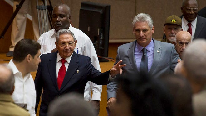In this photo released by Cuba's state-run media Cubadebate, Cuba's President Raul Castro, center left, enters the National Assembly followed by his successor Miguel Diaz-Canel, center right, for the start of two-day legislative session in Havana, Cuba, Wednesday, April 18, 2018. The Cuban assembly selected the 57-year-old First Vice President as the sole candidate to succeed Castro on Wednesday, in a transition aimed at ensuring that the country's single-party system outlasts the aging revolutionaries who created it.