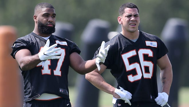 Cincinnati Bengals linebacker Chris Worley (47) talks with linebacker Shawn Miller (56) during rooking mini camp on Friday.