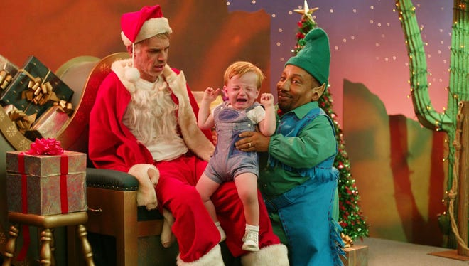 """Billy Bob Thornton, left, and Tony Cox, right appear in a scene from Miramax's """"Bad Santa,"""" in this undated promotional photo."""
