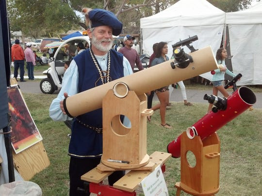Astronomical Society of Las Cruces member Nils Allen stands behind his homemade reflecting telescope at the Renaissance ArtsFaire in 2014.