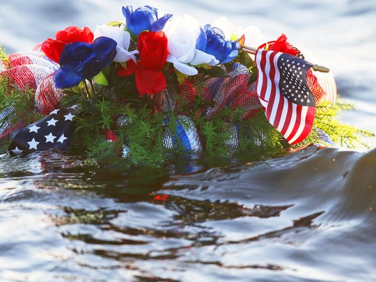 A wreath was laid in the Caloosahatchee River on Sunday during the Tribute to American Heroes event at Centennial Park in downtown Fort Myers. The wreath honored service men and women who died.