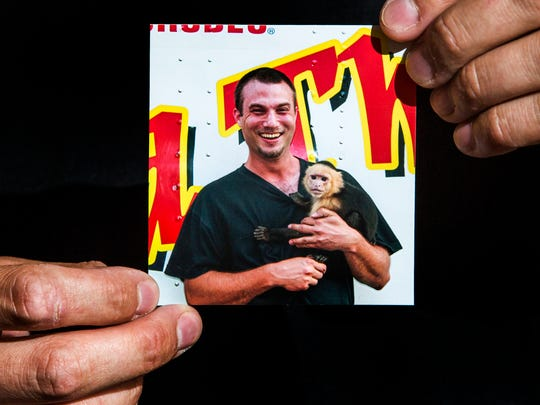 "Nick Blanco holds photo of himself with Cowboy Monkey Rodeo monkey ""Little E"" at his home in Wilmington on Monday evening."