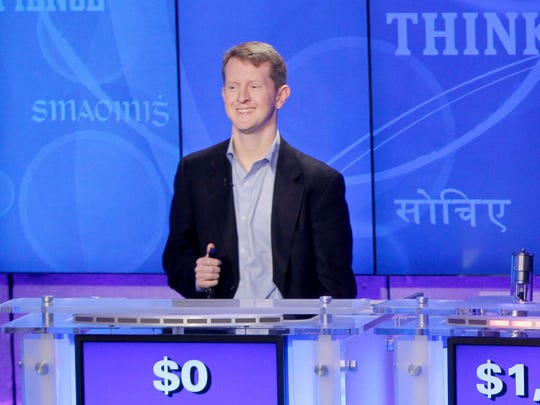 """Rutter, right, returned to """"Jeopardy!"""" in 2011 to compete with Jennings, left, and IBM's question-answering computer system named """"Watson"""" (center)."""