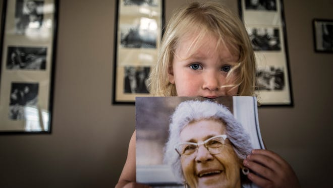 Among the newest generation of the Missisquoi band of Abenaki Indians, Aliza Thomas, 2, holds onto a photograph of her great, great grandmother Mary Jane Lapan, continuing a line that the tribe says they can trace back through the centuries.
