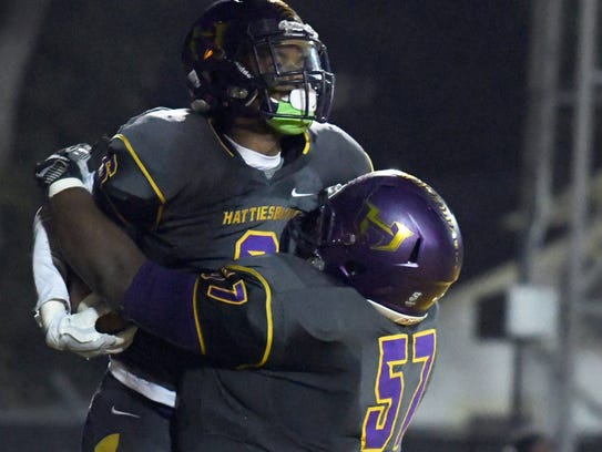 Hattiesburg High running back Drexlan Allen celebrates