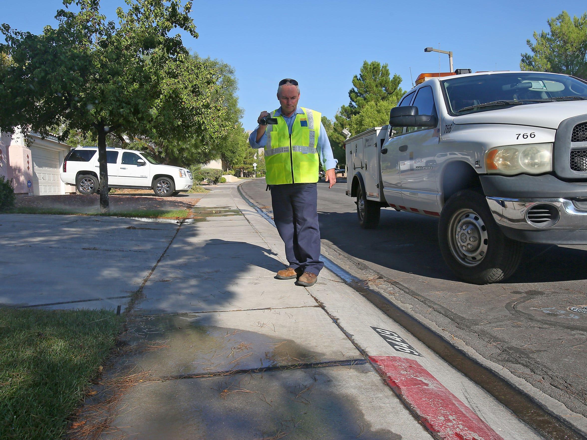 Las Vegas water cop Perry Kaye documents water flowing