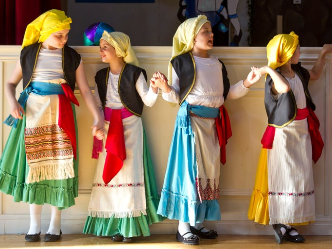 Christiana Simon, 9, Izabela Qirici, 9, Maria Rigopoulis, 10, and Sophia Karakoglou, 10, members of the Kimisis Tis Theotokou beginner dance group prepare for a performance. The Kimisis Tis Theotokou 2014 Greek Frestival takes place at the Greek Orthodox Church in Holmdel and continues through the weekend. Holmdel, NJ Friday, June 6, 2014 Doug Hood