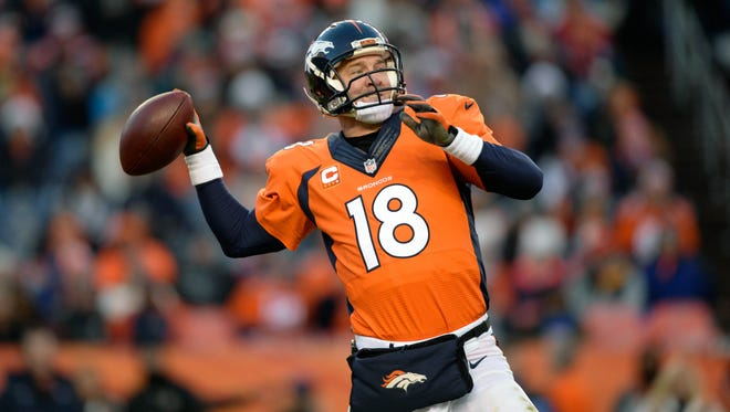 Denver Broncos quarterback Peyton Manning (18) prepares to pass against the Oakland Raiders in the fourth quarter at Sports Authority Field at Mile High. The Broncos defeated the Raiders 47-14.